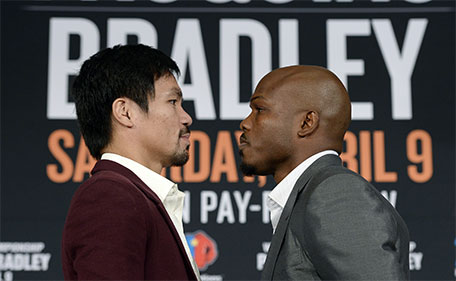 Manny Pacquiao (left) and Timothy Bradley pose after a news conference where they announced their upcoming world welterweight championship bout at the Beverly Hills Hotel January 19, 2016 in Beverly Hills, California. (AFP)