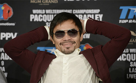 Manny Pacquiao smiles during a news conference where he announce his upcoming world welterweight championship bout against Timothy Bradley at the Beverly Hills Hotel January 19, 2016 in Beverly Hills, California.