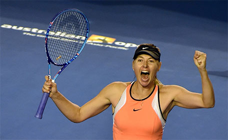 Russia's Maria Sharapova celebrates her win against Switzerland's Belinda Bencic during their women's singles on day seven of the 2016 of the Australian Open tennis tournament in Melbourne on January 24, 2016. (AFP)