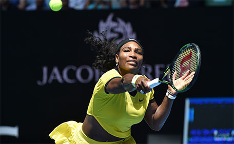 Serena Williams of the US plays a backhand return during her women's singles match against Russia's Margarita Gasparyan on day seven of the 2016 Australian Open tennis tournament in Melbourne on January 24, 2016. (AFP)