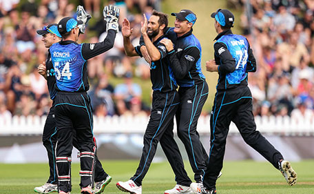 Grant Elliott of New Zealand celebrates with Luke Ronchi and Martin Guptill after taking the wicket of Sohaib Maqsood of Pakistan during the One Day International match between New Zealand and Pakistan at Basin Reserve on January 25, 2016 in Wellington, New Zealand. (Getty Images)