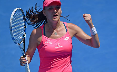 Poland's Agnieszka Radwanska celebrates after victory in her women's singles match against Spain's Carla Suarez Navarro on day nine of the 2016 Australian Open tennis tournament in Melbourne on January 26, 2016. (AFP)