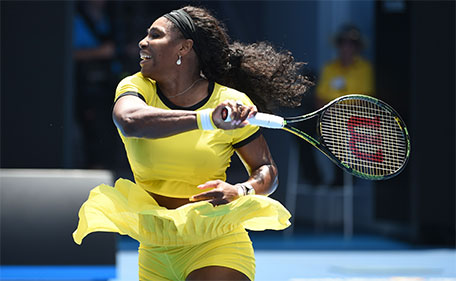 Serena Williams of the US plays a forehand return during her women's singles match against Russia's Maria Sharapova on day nine of the 2016 Australian Open tennis tournament in Melbourne on January 26, 2016. (AFP)