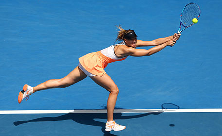 Maria Sharapova of Russia plays a backhand in her quarter final match against Serena Williams of the United States during day nine of the 2016 Australian Open at Melbourne Park on January 26, 2016 in Melbourne, Australia. (Getty Images)