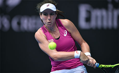 Britain's Johanna Konta plays a backhand return during her women's singles match against China's Zhang Shuai on day ten of the 2016 Australian Open tennis tournament in Melbourne on January 27, 2016. (AFP)