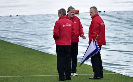 Umpires Bruce Oxenford (right), Billy Bowden (left) and Derek Walker inspect the field as rain delays the start of the second one-day international cricket match between New Zealand and Pakistan at McLean Park in Napier on January 28, 2016. (AFP)
