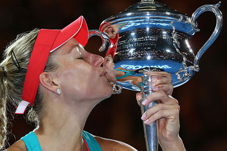 Angelique Kerber of Germany kisses the Daphne Akhurst Trophy after winning the Women's Singles Final against Serena Williams of the United States during day 13 of the 2016 Australian Open at Melbourne Park on January 30, 2016 in Melbourne, Australia. (Getty Images)