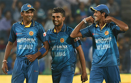 Sri Lanka's bowlers Dusmantha Chameera (left), Dasun Shanaka (centre) and Kasun Rajitha share a light moment Singh during the first T20 international match between India and Sri Lanka at the MCA International Cricket Stadium in Pune on February 9, 2016. (AFP)