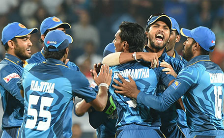 Sri Lanka's captain Dinesh Chandimal (third right) reacts as he greets teammate Dusmantha Chameera after taking the wicket of India's Yuvraj Singh during the first T20 international match between India and Sri Lanka at the MCA International Cricket Stadium in Pune on February 9, 2016.  (AFP)