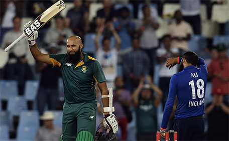 South African batsman Hashim Amla raises his bat after reaching a century during the 3rd One Day International cricket match between South Africa and England at the Centurion Park stadium in Pretoria, South Africa, Tuesday, Feb. 9, 2016. (AP)