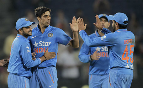 India's Ashish Nehra (second left) celebrates a Sri Lankan wicket during their first Twenty20 cricket match in Pune, India, Tuesday, Feb. 9, 2016. (AP)