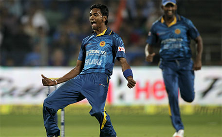 Sri Lanka cricket player Dushmantha Chameera celebrates during the first T20 match between India and Sri Lanka in Pune, India, Tuesday, Feb 9, 2016. (AP)
