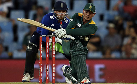 South Africa's batsman Quinton de Kock, (right) misplays a shot as England's wicketkeeper Jos Buttler watches during the 3rd One Day International cricket match between South Africa and England at the Centurion Park stadium in Pretoria, South Africa, Tuesday, Feb. 9, 2016. (AP)