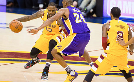 LeBron James #23 of the Cleveland Cavaliers tries to drive around Kobe Bryant #24 of the Los Angeles Lakers during the second half at Quicken Loans Arena on February 10, 2016 in Cleveland, Ohio. (AFP)
