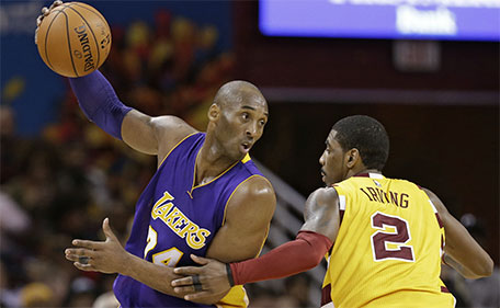 Los Angeles Lakers' Kobe Bryant (24) drives against Cleveland Cavaliers' Kyrie Irving (2) in the second half of an NBA basketball game Wednesday, Feb. 10, 2016, in Cleveland. The Cavaliers won 120-111. (AP)