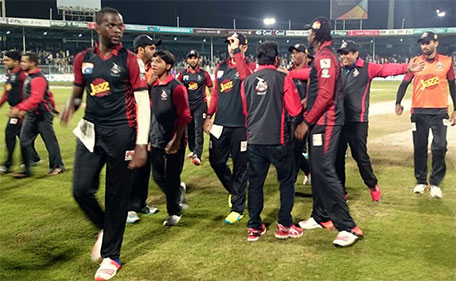 Kevon Cooper of Lahore Qalandars leads the team out after they beat Peshawar Zalmi in Match 15 of the PSL at Sharjah Cricket Stadium on February 13 2016. (@PSL)