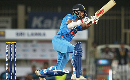 India's Shikhar Dhawan plays a shot during the second  T20 international match between India and Sri Lanka at the Jharkhand State Cricket Association International Stadium Complex in Ranchi on February 12, 2016. (AFP)