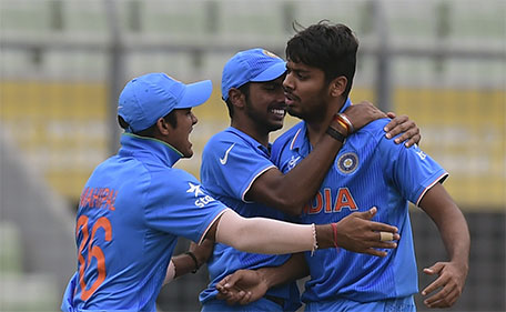 Indian cricketer Avesh Khan (right) celebrates after the dismissal of the West Indies cricketer Gidron Pope during the under-19s World Cup cricket final between India and West Indies at the Sher-e-Bangla National Cricket Stadium in Dhaka on February 14, 2016. (AFP)