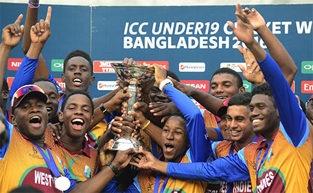 West Indies cricketers pose with the trophy after winning the Under-19 World Cup cricket final between India and West Indies at the The Sher-e-Bangla National Cricket Stadium in Dhaka on February 14, 2016. (AFP)