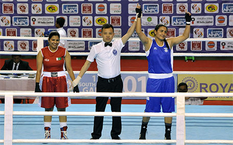 Indian boxer Pooja Rani (right) reacts after winning against Pakistan's Javed Sofiya at the 12th South Asian Games 2016 in Shillong on February 14, 2016. (AFP)
