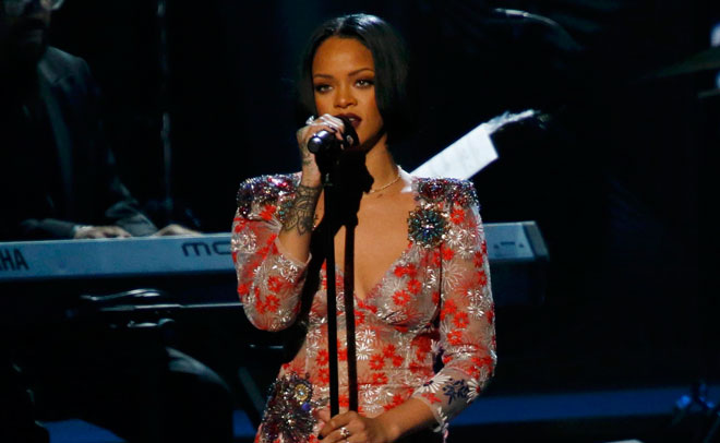 "Singer Rihanna performs ""Say You, Say Me"" at the 2016 MusiCares Person of the Year gala in Los Angeles, California February 13, 2016. (Reuters)"