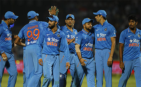 India's captain Mahendra Singh Dhoni (centre) celebrates with teammates at the end of first innings of their third Twenty20 cricket match against Sri Lanka, in Vishakapatnam, India, Sunday, Feb. 14, 2016. (AP)