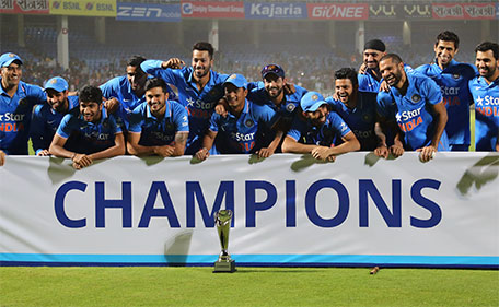 Members of Indian cricket team celebrate with the winning trophy after their Twenty20 cricket series win against Sri Lanka, in Vishakapatnam, India, Sunday, Feb. 14, 2016. India won the series 2-1. (AP)