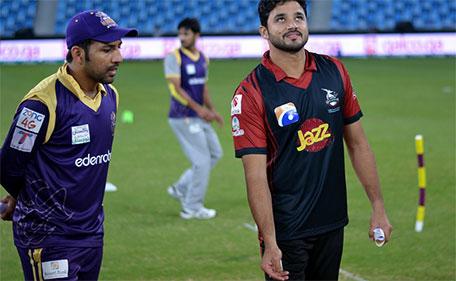 Azhar Ali (right) of Lahore Qalandars tosses the coin during the Match 18 of PSL against Quetta Gladiators at Dubai International Stadium on February 16 2016. (@PSL)