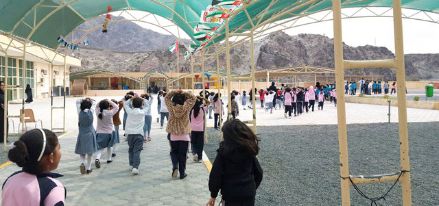 Students being evacuated from a Fujairah school. (Al Bayan)