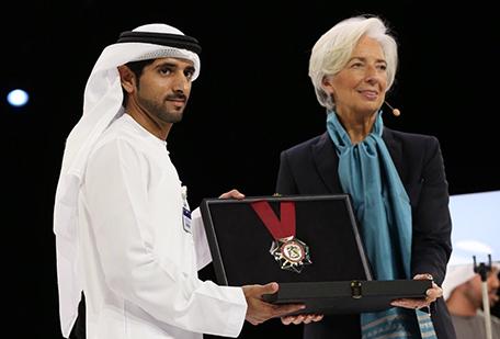 Sheikh Hamdan bin Mohammed bin Rashid Al Maktoum is giving out gold medal to Christine Lagarde, Managing Director, International Monetary Fund (IMF).