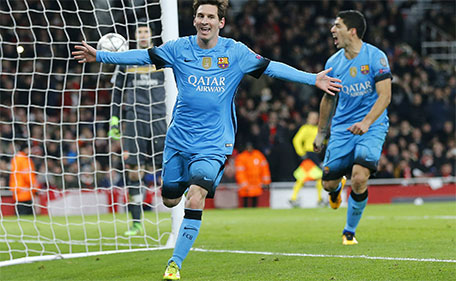 Barcelona's Lionel Messi (left) celebrates after he scored the second goal during the soccer Champions League round of 16 first leg soccer match between Arsenal and Barcelona at the Emirates stadium in London, Tuesday, Feb. 23, 2016. (AP)