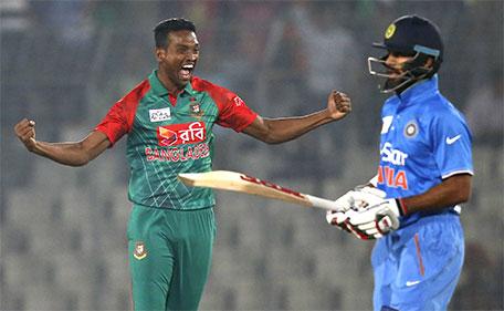 Bangladesh's Al–Amin Hossain celebrates the wicket of India's Shikhar Dhawan (right) during the Asia Cup Twenty20 international cricket tournament in Dhaka, Bangladesh, Wednesday, Feb. 24, 2016. (AP)