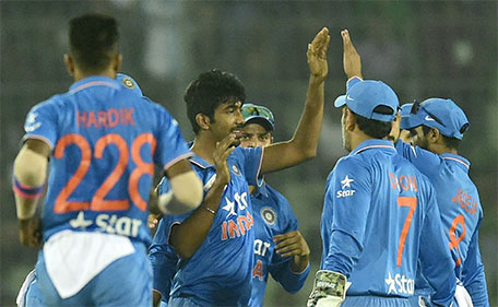 Indian cricketer Jasprit Bumrah (centre) celebrates with teammates after the dismissal of Bangladesh batsman Soumya Sarkar during a Twenty20 cricket match between India and Bangladesh for the Asia Cup T20 cricket tournament at The Sher-e-Bangla National Cricket Stadium in Dhaka on February 24, 2016. (AFP)