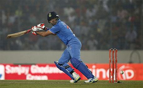 India's Yuvraj Singh plays a shot against Bangladesh during the Asia Cup Twenty20 international cricket match in Dhaka, Bangladesh, Wednesday, Feb. 24, 2016. (AP)