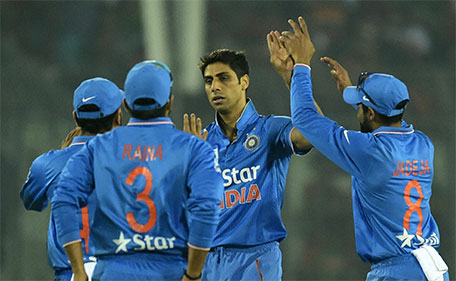 Indian cricketer Ashish Nehra (centre) celebrates with teammates after the dismissal of Bangladesh batsman Mohammad Mithun during a Twenty20 cricket match between India and Bangladesh for the Asia Cup T20 cricket tournament at The Sher-e-Bangla National Cricket Stadium in Dhaka on February 24, 2016. (AFP)
