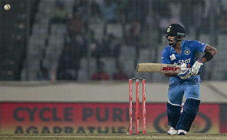 India's Virat Kohli plays a shot during the Asia Cup Twenty20 international cricket match against Pakistan in Dhaka, Bangladesh, Saturday, Feb. 27, 2016. (AP)
