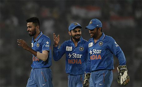 Indian cricketers  Hardik Pandya (left) and Virat Kohli (centre) and captain Mahendra Singh Dhoni react after the dismissal of the Pakistan cricketer Mohammad Sami during the match between India and Pakistan at the Asia Cup T20 cricket tournament at the Sher-e-Bangla National Cricket Stadium in Dhaka on February 27, 2016. (AFP)