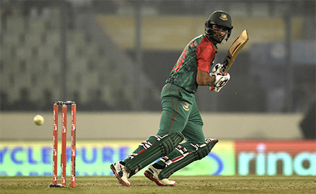 Bangladesh cricketer Mohammad Mahmudullah plays a shot during the match between Bangladesh and United Arab Emirates at the Asia Cup T20 cricket tournament at the Sher-e-Bangla National Cricket Stadium in Dhaka on February 26, 2016. (AFP)