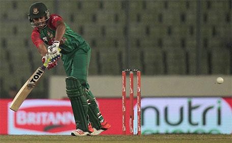 Bangladesh's Mohammad Mithun plays a shot during their Asia Cup Twenty20 international cricket match against United Arab Emirates in Dhaka, Bangladesh, Friday, Feb. 26, 2016. (AP)