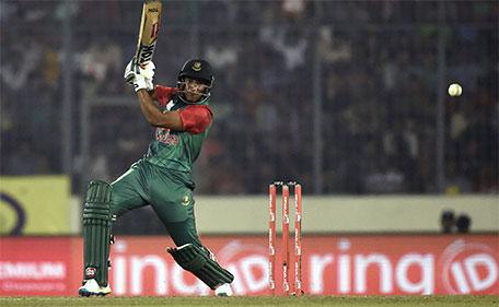 Bangladesh cricketer Shakib Al Hasan plays a shot during the match between Bangladesh and  Sri Lanka at the Asia Cup T20 cricket tournament at the Sher-e-Bangla National Cricket Stadium in Dhaka on February 28, 2016. (AFP)