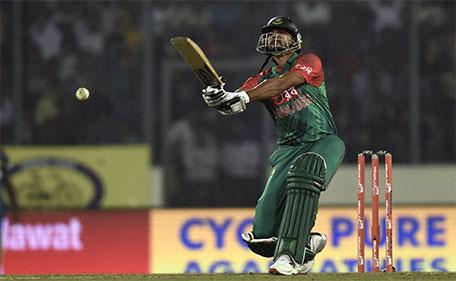 Bangladesh cricket captain Mashrafe Bin Mortaza plays a shot during the match between Bangladesh and  Sri Lanka at the Asia Cup T20 cricket tournament at the Sher-e-Bangla National Cricket Stadium in Dhaka on February 28, 2016. (AFP)