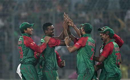 Bangladesh's Al–Amin Hossain, second left, celebrates with his teammates the dismissal of Sri Lanka's captain Angelo Mathews during the Asia Cup Twenty20 international cricket match in Dhaka, Bangladesh, Sunday, Feb. 28, 2016. (AP)