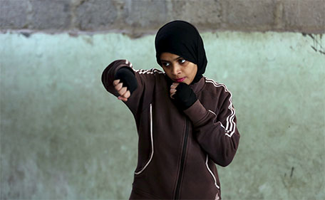 Misbah, 17, takes part in warm up exercises at the first women's boxing coaching camp in Karachi, Pakistan February 19, 2016. (Reuters)