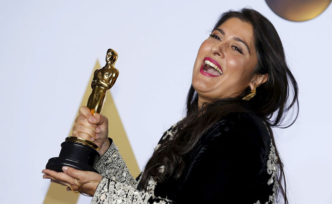 Pakistani journalist and filmmaker Sharmeen Obaid-Chinoy, winner of Best Documentary Short Subject Film for 'A Girl in the River: The Price of Forgiveness', poses during the 88th Academy Awards in Hollywood, California February 28, 2016. (Reuters)
