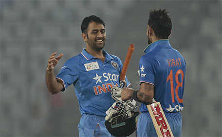 India's captain Mahendra Dhoni (left) celebrates with his teammate Virat Kohli  after winning the Asia Cup Twenty20 international cricket match against Sri Lanka in Dhaka, Bangladesh, Tuesday, March 1, 2016. (AP)