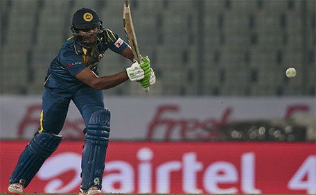 Sri Lanka's Chamara Kapugedera plays a shot during the Asia Cup Twenty20 international cricket match against India in  Dhaka, Bangladesh, Tuesday, March 1, 2016. (AP)