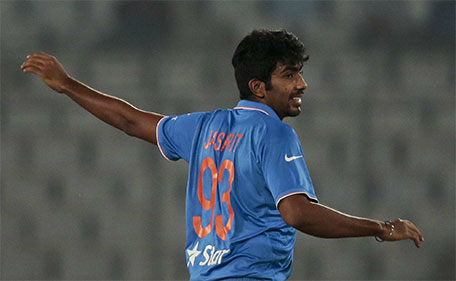 India's Jasprit Bumrah reacts after claiming the wicket of Sri Lanka's Shehan Jayasuriya during their Asia Cup Twenty20 international cricket match in Dhaka, Bangladesh, Tuesday, March 1, 2016. (AP)