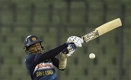 Sri Lanka cricketer Tillakaratne Dilshan plays a shot during the Asia Cup T20 cricket tournament match between India and Sri Lanka at the Sher-e-Bangla National Cricket Stadium in Dhaka on March 1, 2016. (AFP)