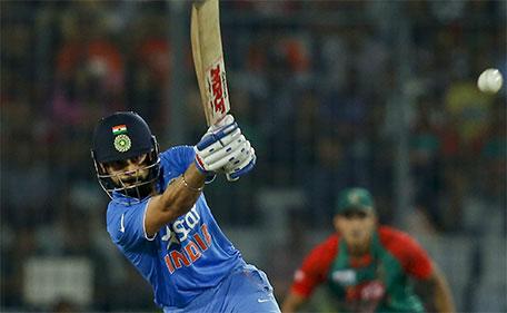 India's Virat Kohli plays a shot during the Asia Cup Twenty20 international cricket final match against Bangladesh in Dhaka, Bangladesh, Sunday, March 6, 2016. (AP)