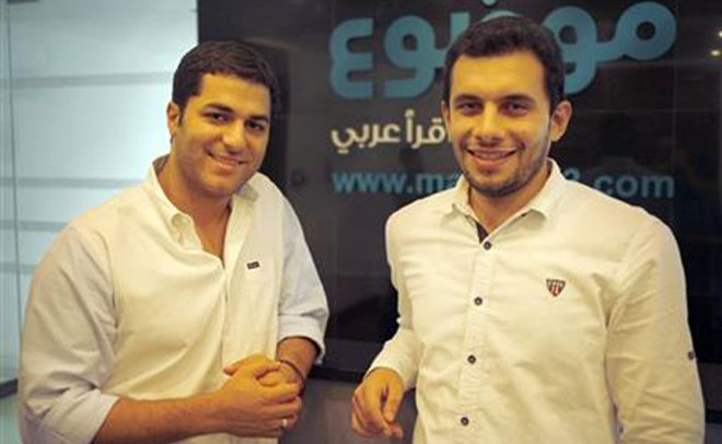 In this Sept. 6, 2015 photo, Rami Qawasmi, left, and Mohammad Jaber?, co-founders of Mawdoo3.com, the second-largest Arabic-language site in the Middle East, pose for a photo in Amman, Jordan. (AP)